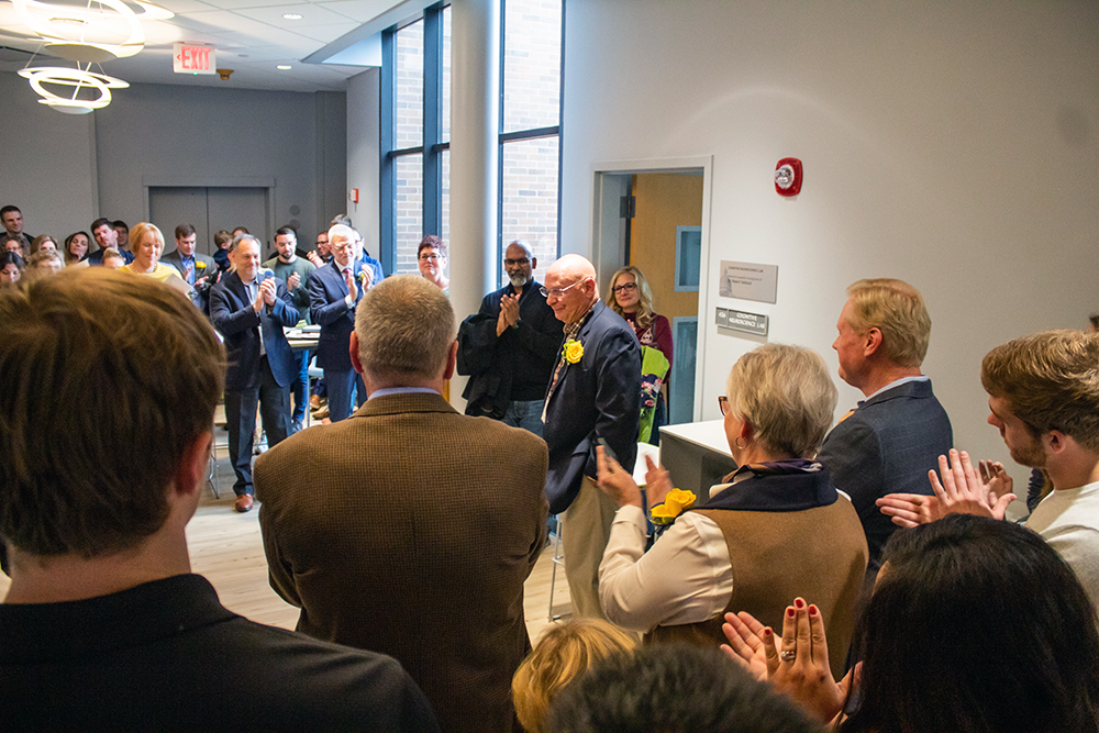 Image of Dr. Robert Tallitsch giving a speech outside Hanson 436, a room in Augustana College's Hanson Hall of Science that was dedicated to him after he left the college